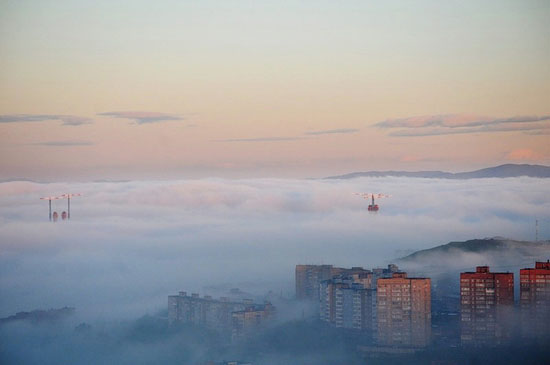 Mysterious fog over Vladivostok city, Russia view 8