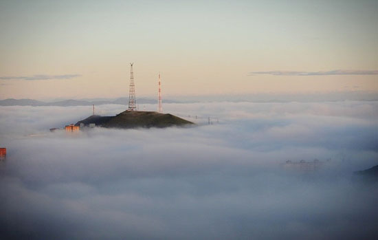 Mysterious fog over Vladivostok city, Russia view 9