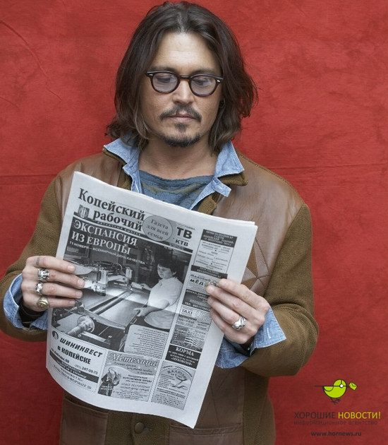 Johnny Depp with the Russian newspaper