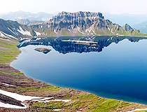 The lake in the caldera of the volcano on Kamchatka